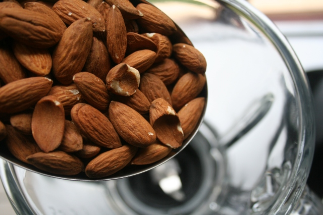 Add the almonds to blender bowl.
