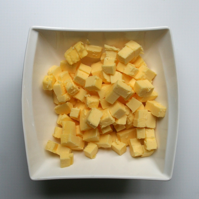 Chop butter into 3 cm (1/2 inch) pieces and put into the freezer while you prepare the other dry ingredients.