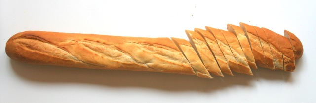 Slice bread into centimeter   (1/2 inch) wide slices.