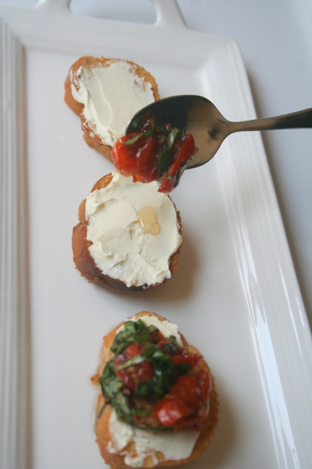 Spoon tomato basil mixture onto the cheese topped toasts.