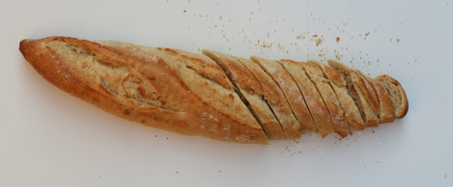 Slice bread with a sharp bread knife.