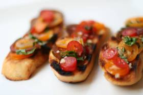 Spoon tomato mixture onto bread just before serving and enjoy!